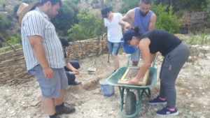 Architecture students learning how to make adobe bricks from the soil they stood on to build a new classroom build a new